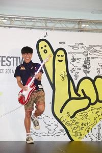 The Festival Ambassador Crowd Lu plays guitar in the pre