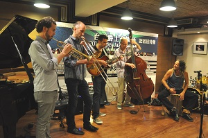 From left to right, saxophonist Rosario Giuliani, trombonist Alan Ferber of the U.S., guitarist Joachim Schoenecker of Germany, double bassist Bart De Nolf of Belgium, and percussionist Gilad Dobrecky of Israel perform at a press conference on July 17th in Taipei.
