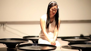 New York-based artist Lisa Park uses an EEG headset to transmit brainwave data via Bluetooth to her computer. Software then translates the brain waves into sounds and each of the different sounds is assigned to one of five speakers. (Photo courtesy of the Department of Cultural Affairs)