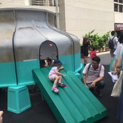 2. A girl glides down the slide as her father watches. (Photo courtesy of DOCA)