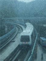 An MRT Train Running in the Rain