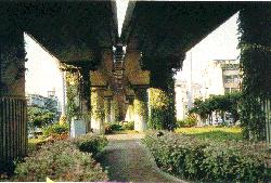 parks under elevated stations and tracks on the tamsui line