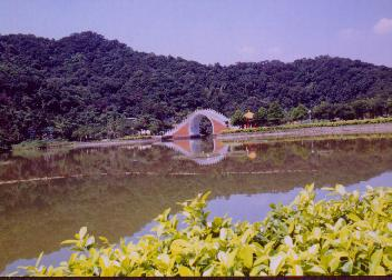 arch-shaped bridge over the lake