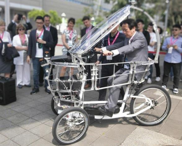 Deputy Mayor Charles Lin trying out the PEV (persuasive electric vehicle) self-driving tricycle