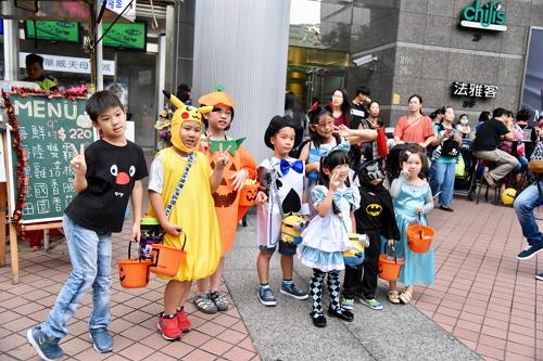 kids dressed up in Halloween costumes
