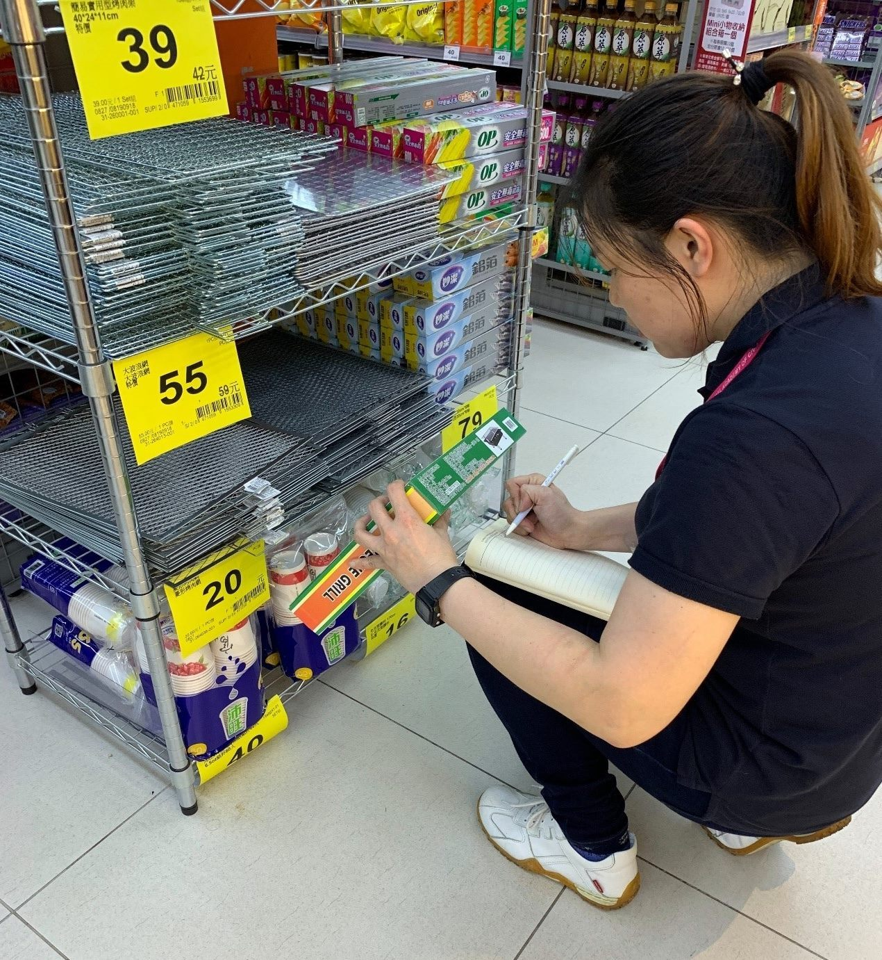 Store staff at big box retailer examining goods used for barbecue