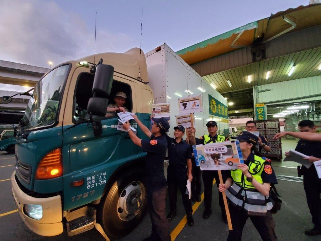 Police promoting pedestrian awareness safety tips to truck drivers