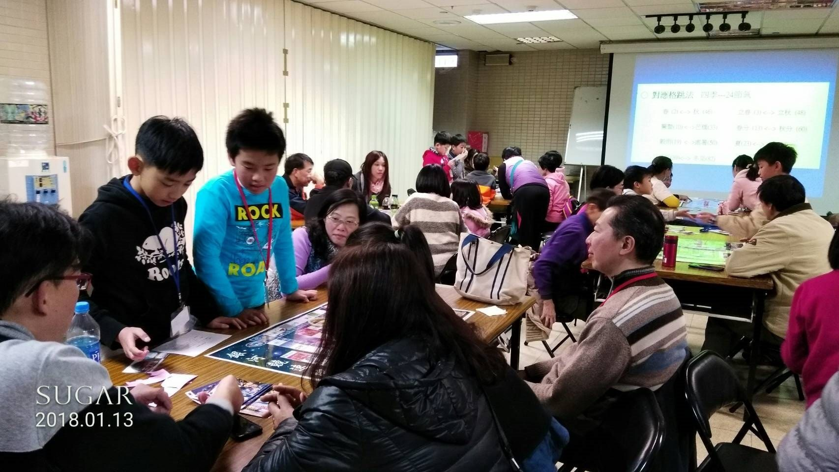 Participants taking part in the tablegame event organized by TAM