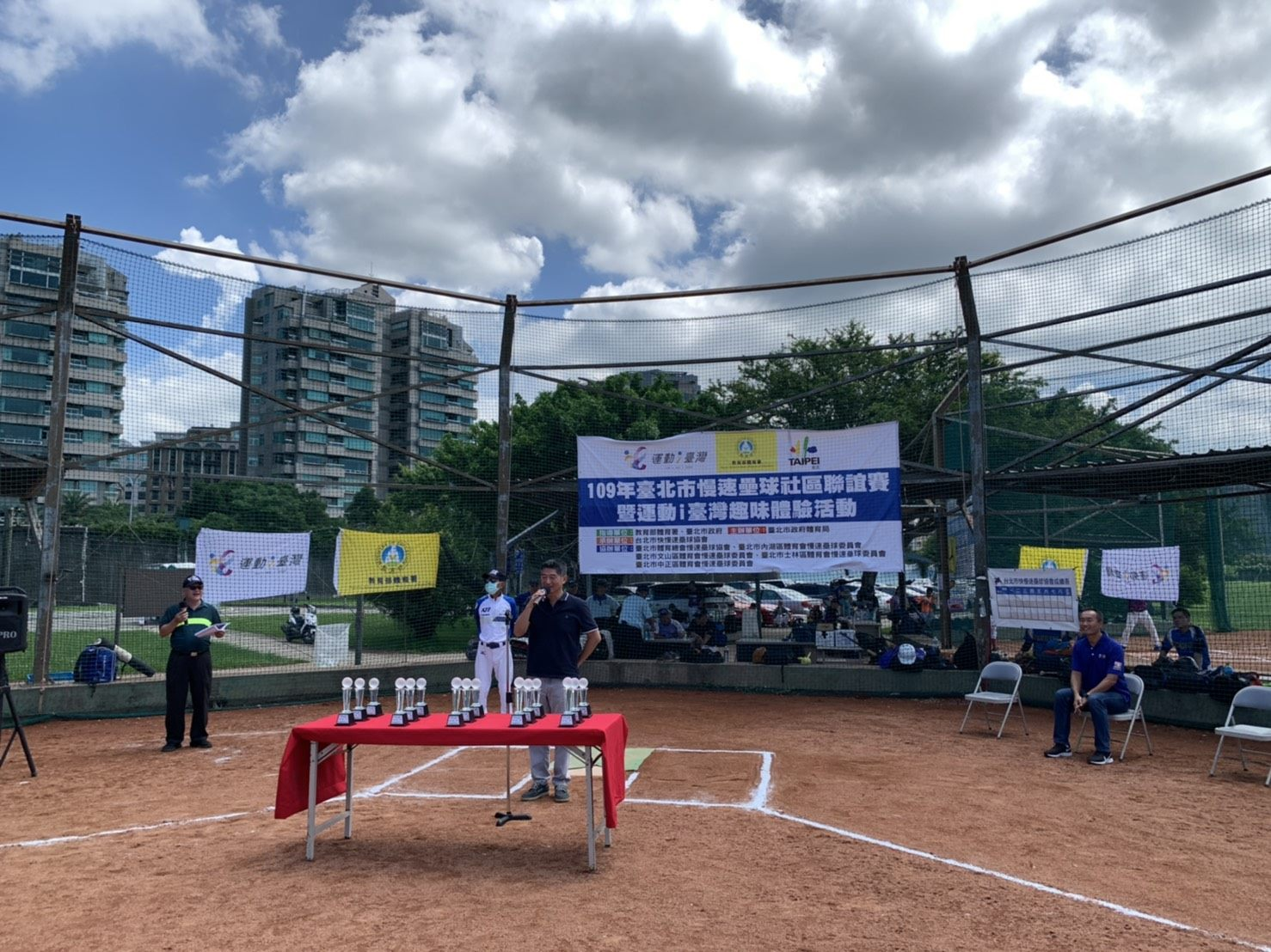 The opening ceremony of the community softball tournament.