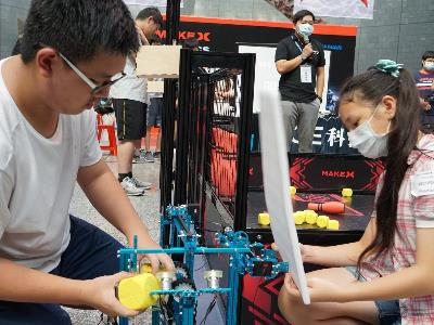 Contestants working on their robot at the competition