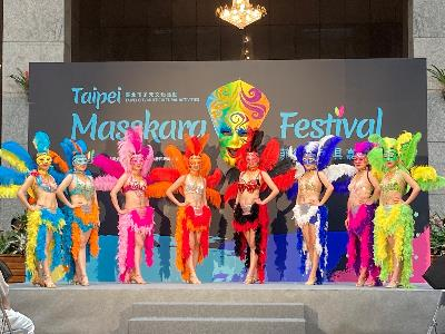 The press conference for Taipei Masskara Festival with individuals wearing smiling masks and extravagant attires