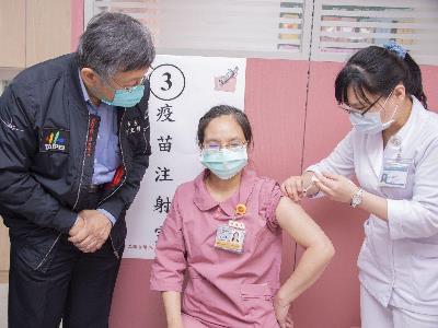 Nurse receiving COVID-19 vaccination