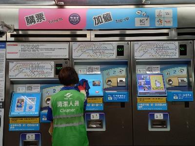 Disinfection and cleaning of the ticket vending machine inside a local MRT Station