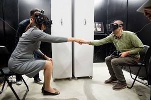 Users trying out goggles and a headset that show what the other person is looking at.