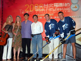 Commissioner Liao, Chairman Wang, Similia, and hockey players