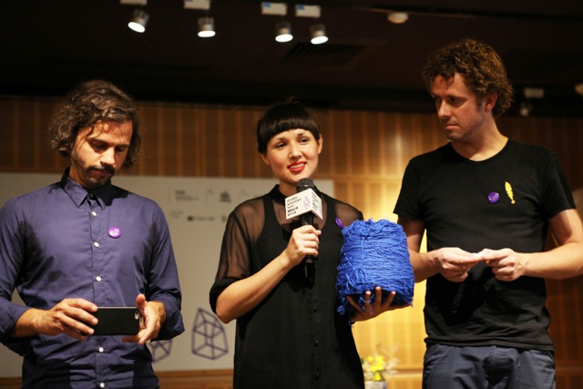 4. This year's World Design Capital foreign designers in residence (from left to right) Siem Nozza, Victoria Ledig, and Vincent Wittenberg present the objects found in Taipei that impressed them the most at the press conference on Wednesday, July 27. Ledig holds a bundle of yarn found in a factory in Taipei. Photo Courtesy of WDC 2016 Taipei.