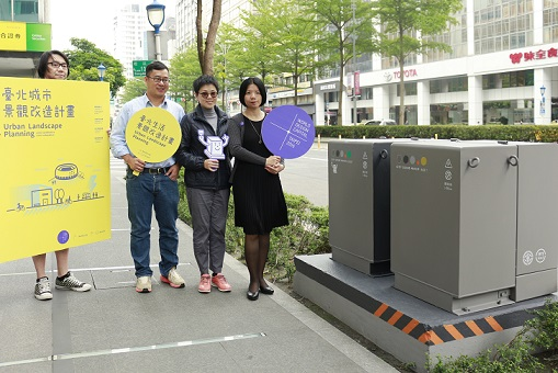 3. Taipei Department of Cultural Affairs Commissioner Beatrice Pei-ni Hsieh (right) thanks the Taiwan Power Company at the May 11 press conference for their help redesigning transformer boxes.