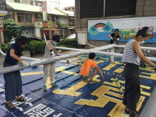 4. Members of the work team and volunteers paint poles with primer. (Photo courtesy of DOCA).
