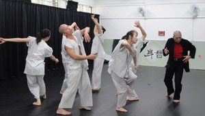 Liu Shau-lu, right, practices with dancers in his group Taipei Dance Circle in the rehearsal room. (Photos by Eva Tang)