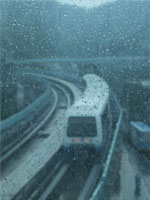 An MRT Train Running in the Rain, jpg download, opened with new window