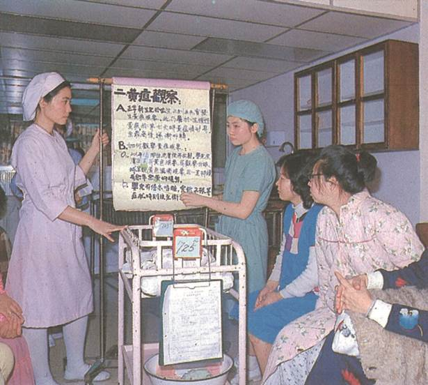 Delivery Room Nurses Instruct on Baby Nursing Know-how, 1982