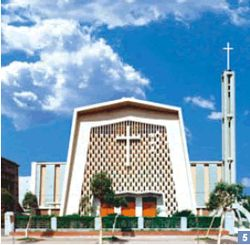 5. Holy Family Catholic Church has a design using a simple rectangular geometric pattern to complement the cross, creating an ambiance of holy solemnity.