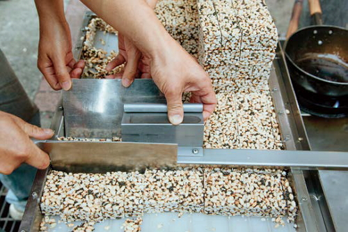 After pressing, the warm cakes cool and set. They are then cut into smaller pieces to bepackaged and sold.