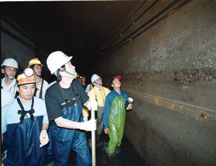 The maintenance personnel go to the Underground Sewers during Typhoon Period.
