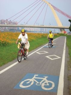 Ride your bike along the river and feel the wind in your hair.