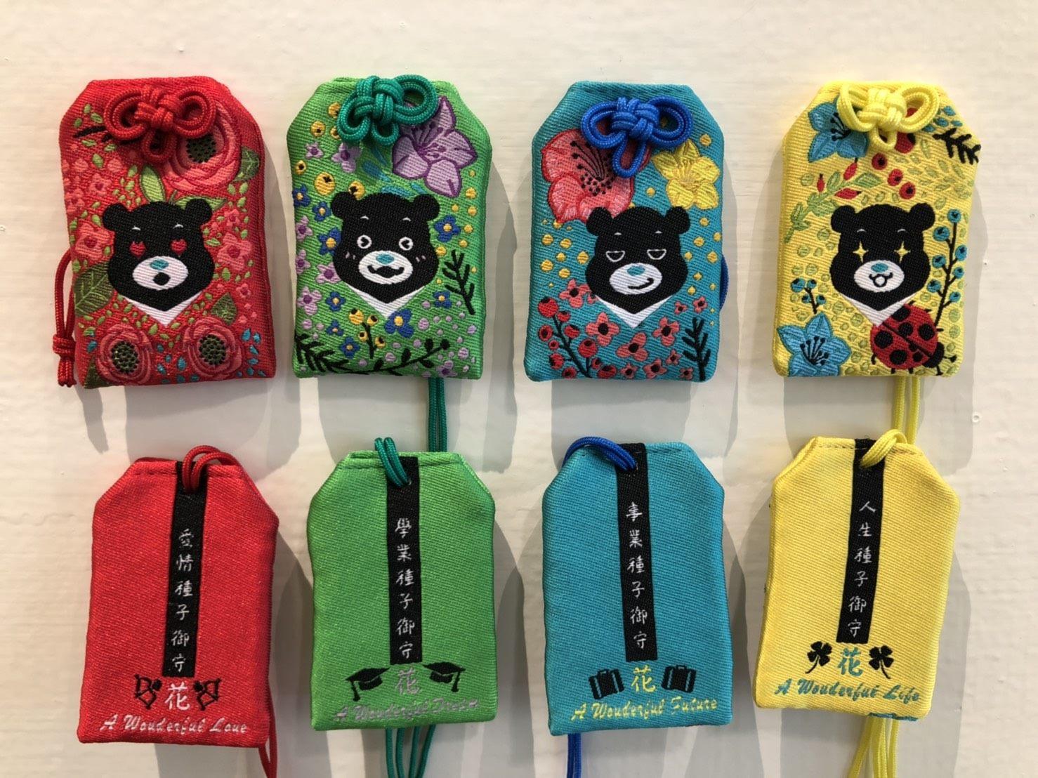 「幸福嘉年華」活動現場的城市紀念品攤位可買到花季限定版的熊讚御守。