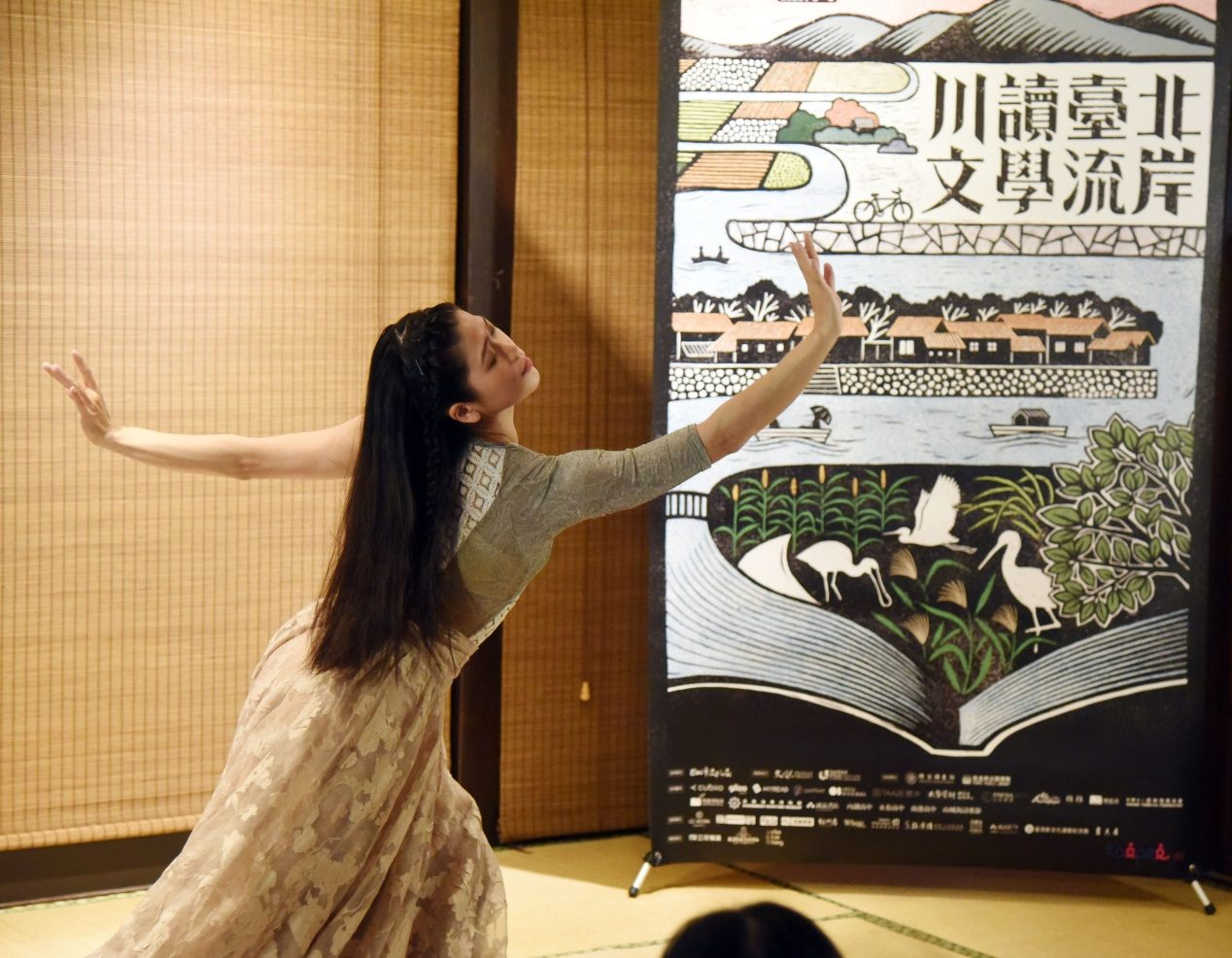 One dancer from the Water Reflection Dance Ensemble performs at the press conference of the Festival on February 20.