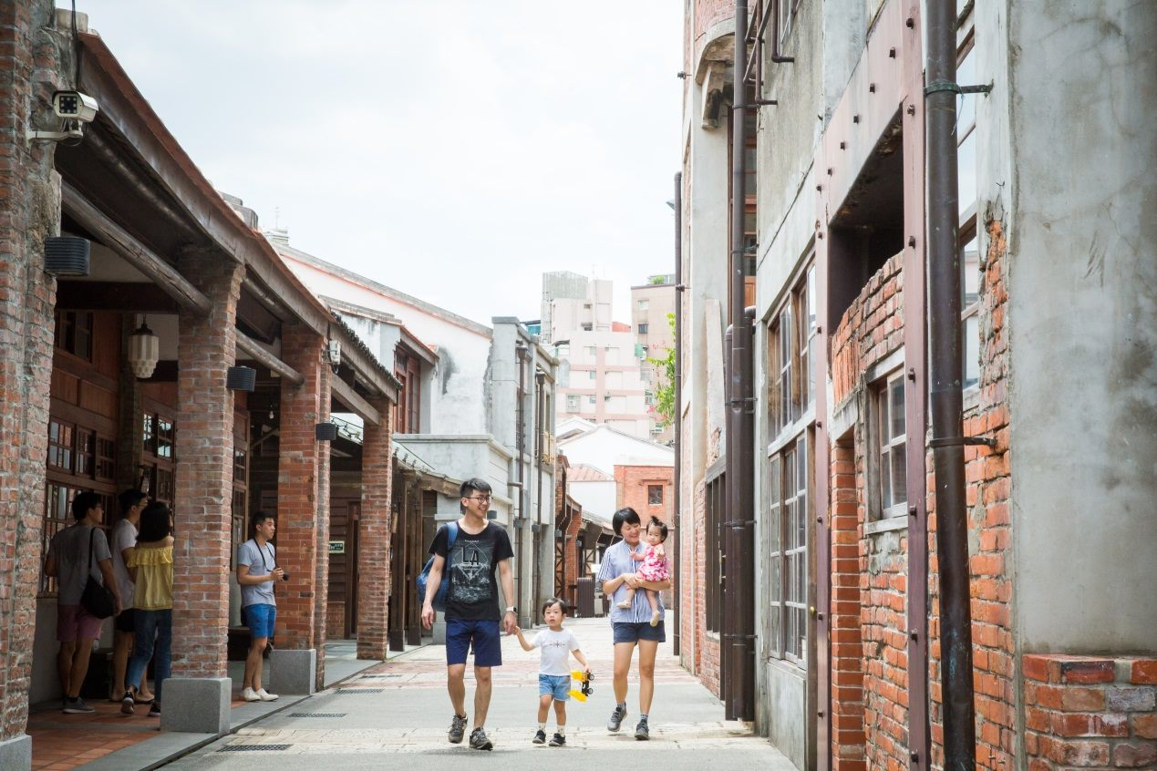 A family walks along the old street at the Bopiliao Historical Block.