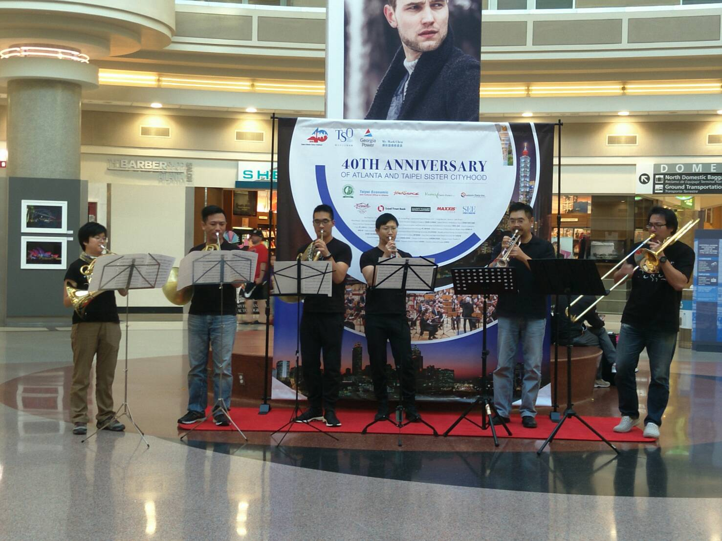 The sextet actually did a flash mob show at the airport.