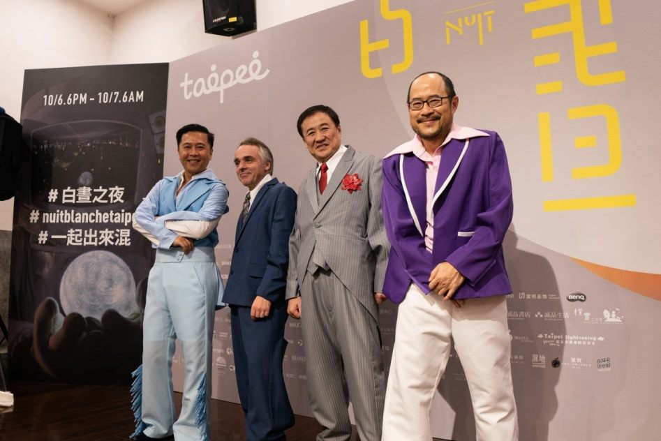 Commissioner of Taipei City's Department of Cultural Affairs wear designer clothes during the press conference on September 27.