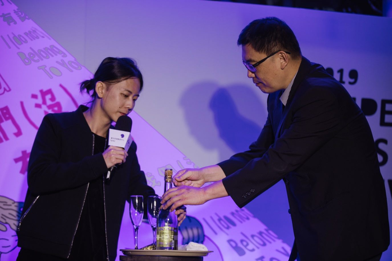 Deputy Director Tian helps artist Zhou Rui-Xiang perform a magic show