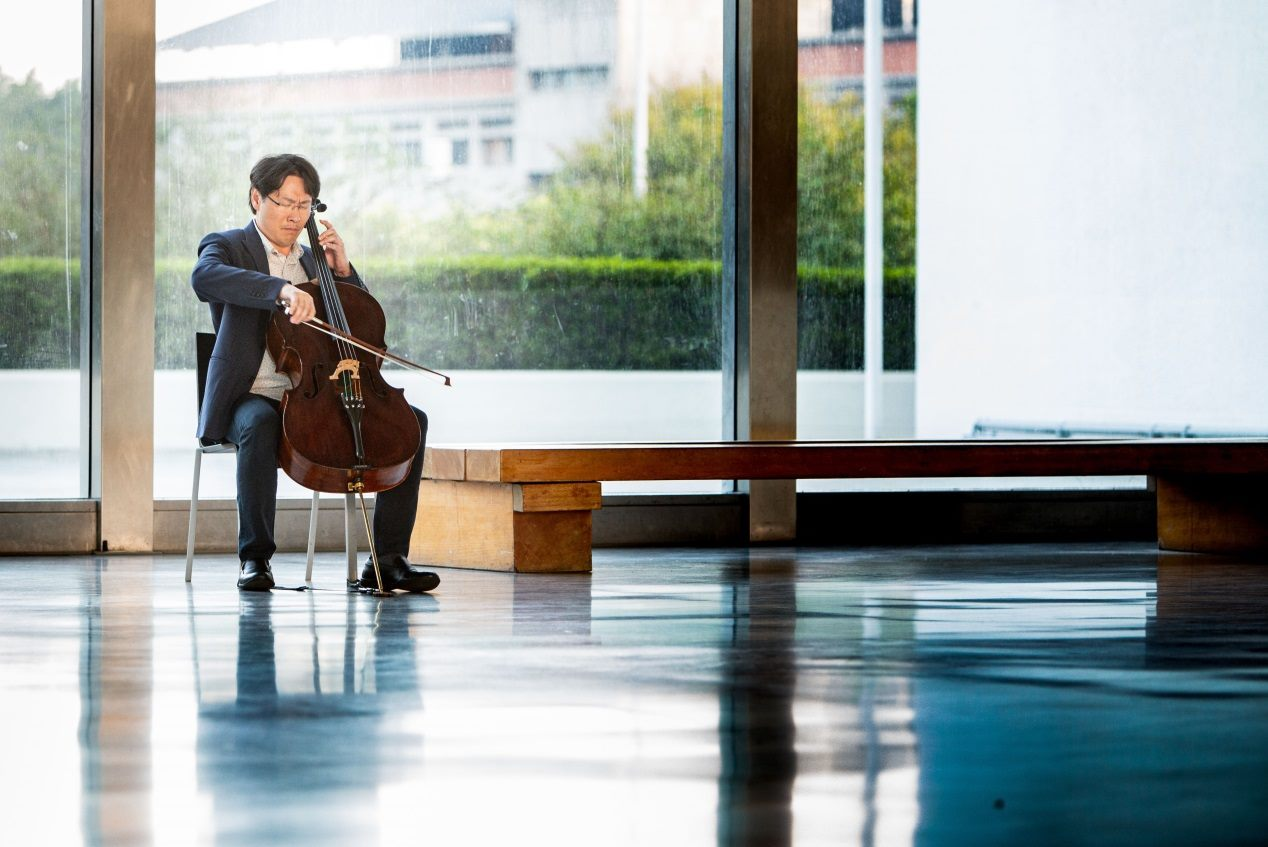 Taiwanese-American cellist Kenneth Kuo rehearses at Taipei Fine Arts Museum.