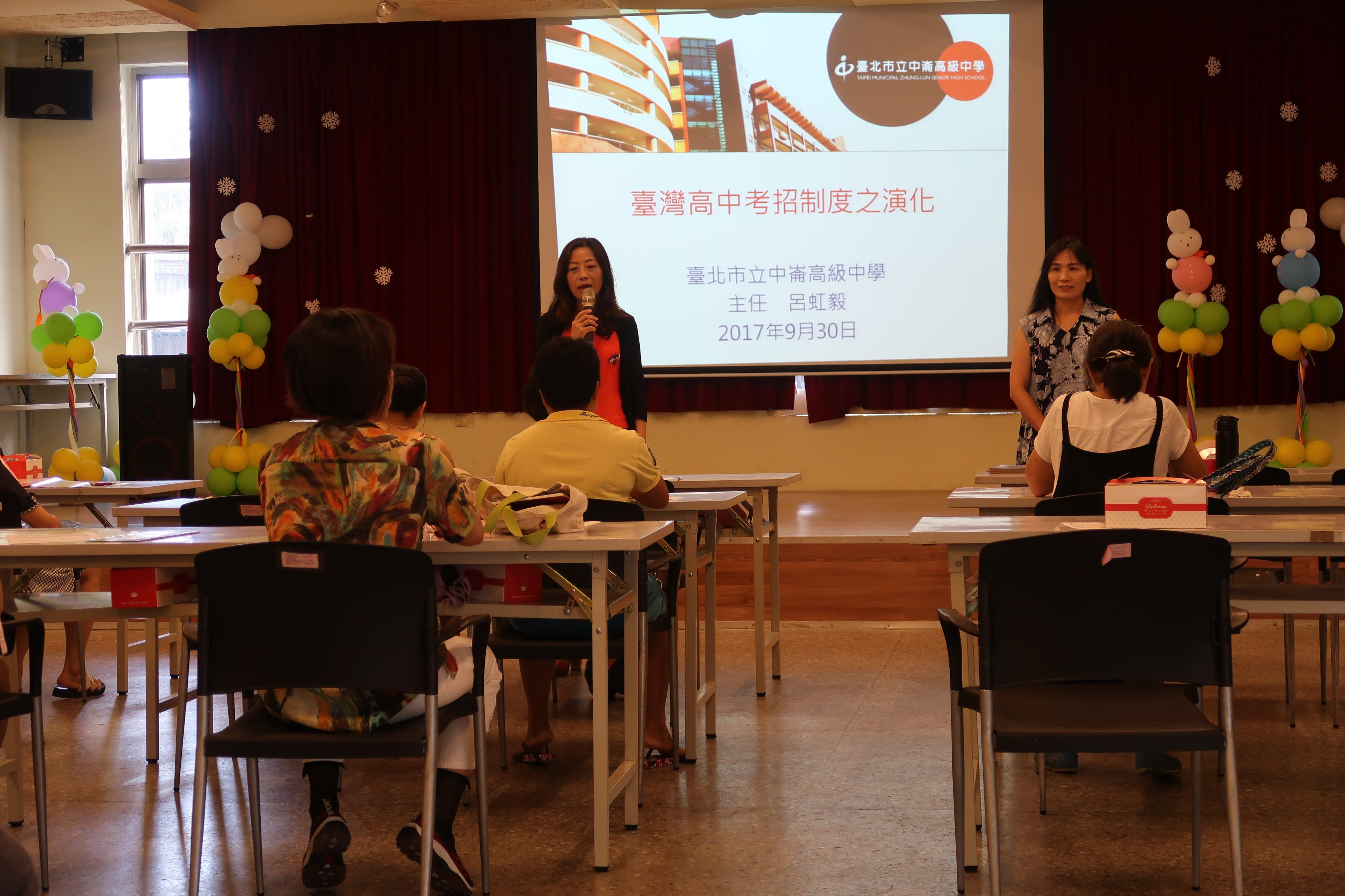 Taipei Department of Education explaining the focus of the meeting.