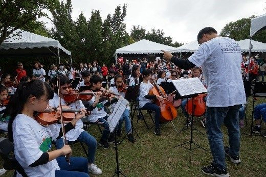 School orchestra playing at the Guandu Nature Park 20th anniversary fair